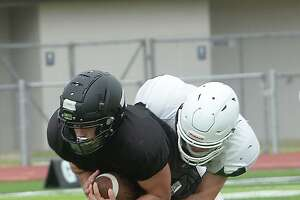 Vidor runs the ball during a scrimmage between Vidor and Hemphill in Vidor Thursday morning. Photo taken Thursday, September 3, 2020 Kim Brent/The Enterprise