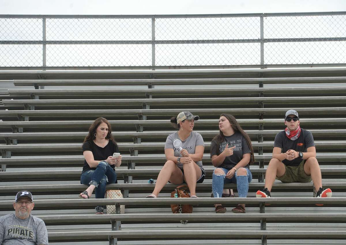 Vidor fans gather to root on the Pirates during a scrimmage between Vidor and Hemphill in Vidor Thursday morning. Photo taken Thursday, September 3, 2020 Kim Brent/The Enterprise