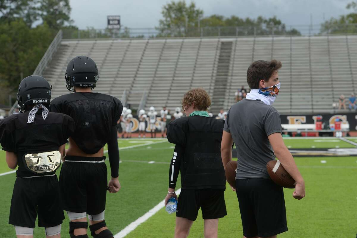 Vidor players gather on the sidelines inbetween plays during a scrimmage between Vidor and Hemphill in Vidor Thursday morning. Photo taken Thursday, September 3, 2020 Kim Brent/The Enterprise