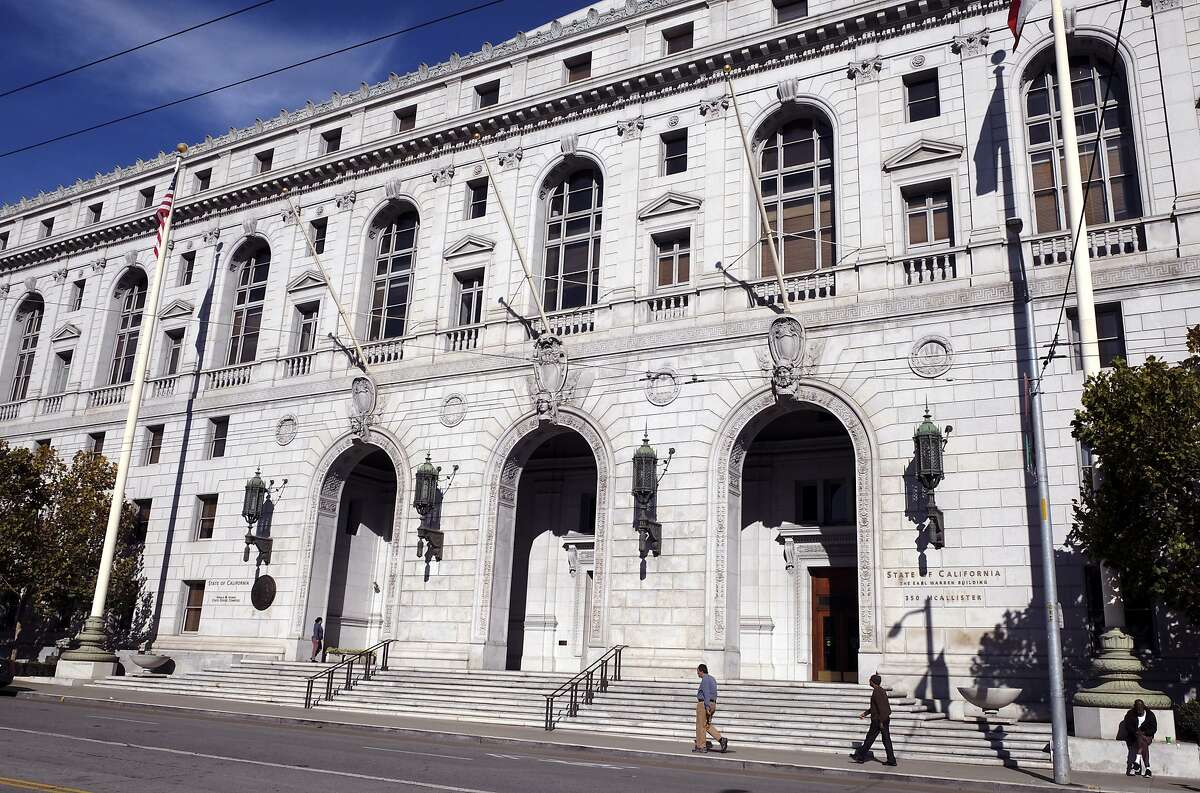 """FILE - In this Jan. 2, 2019, file photo, people walk past the Earl Warren Building that houses the California Supreme Court in San Francisco. Los Angeles County must pay a full $8 million damages award to the family of a Black man whose death evoked the more resent death of George Floyd in Minneapolis, the California Supreme Court ruled Monday, Aug. 10, 2020. While subduing Darren Burley in 2012, Los Angeles sheriff's deputies """"used their knees to pin him to the ground with as much body weight as possible,"""" according to the court's unanimous ruling. (AP Photo/Eric Risberg, File)"""