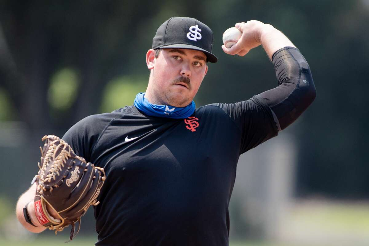 John Gavin works out with his throwing partner on a baseball field at Gunderson High School in San Jose on Sept. 2, 2020. Gavin, a minor-league pitching prospect for the San Francisco Giants, is currently rehabbing from Tommy John surgery.