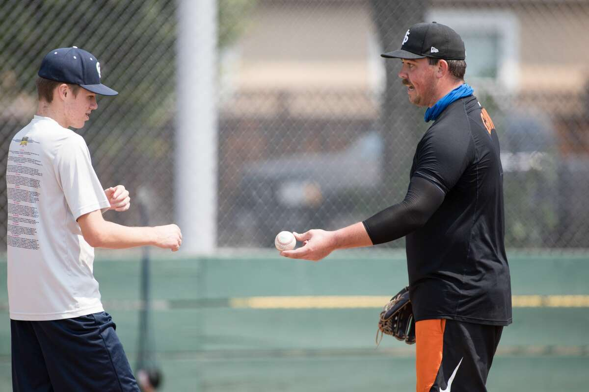 John Gavin, right, explains a throwing technique to his throwing partner, Luka Pinta, at Gunderson High School in San Jose on Sept. 2, 2020. Gavin, a minor-league pitching prospect for the San Francisco Giants, is currently rehabbing from Tommy John surgery.