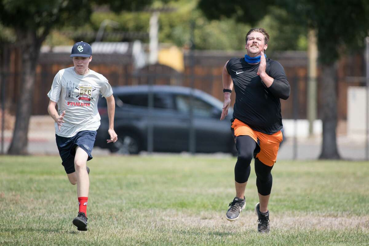 John Gavin, right, runs sprints with his throwing partner, Luka Pinta, at Gunderson High School in San Jose on Sept. 2, 2020. Gavin, a minor-league pitching prospect for the San Francisco Giants, is currently rehabbing from Tommy John surgery.