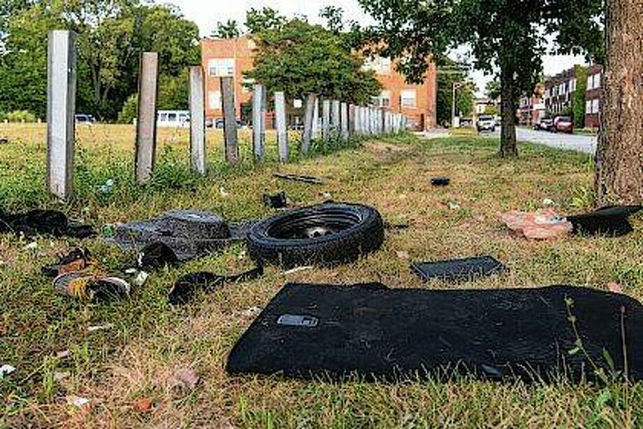 Debris left from a fatal car crash that killed a 10-year-old girl litters the ground Wednesday on Chicago's South Side. Photo: Tyler LaRiviere | Chicago Sun-Times Via AP