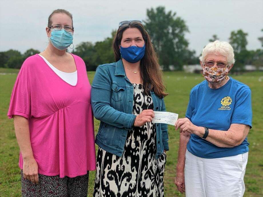 From left, Midland Civitan Club Treasurer Beckie Bradshaw and Club President Ginny Bakersafely present a check for $2,500 to support The Middle of the Mitt Miracle Field to Marcie Post, Recreation Manager for Midland Parks and Recreation. (Photo provided)