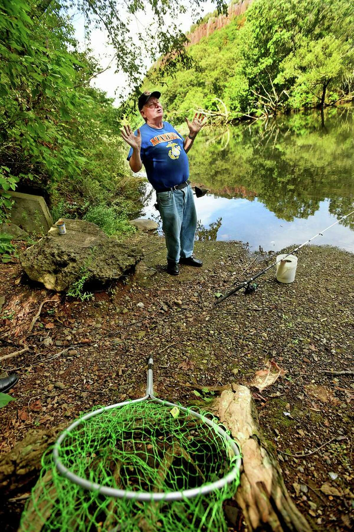 Ray Zalenski, 66, of New Haven fishes for carp at a small bank along the Mill River behind Wilbur Cross High School. He is retired and finds fishing therapeutic.