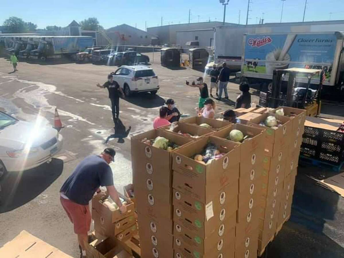 Area residents may pick up a free box containing 20 pounds of fresh fruits and vegetables Labor Day at Wade's Dairy, 1316 Barnum Avenue, Bridgeport. This is a photo from the August distribution