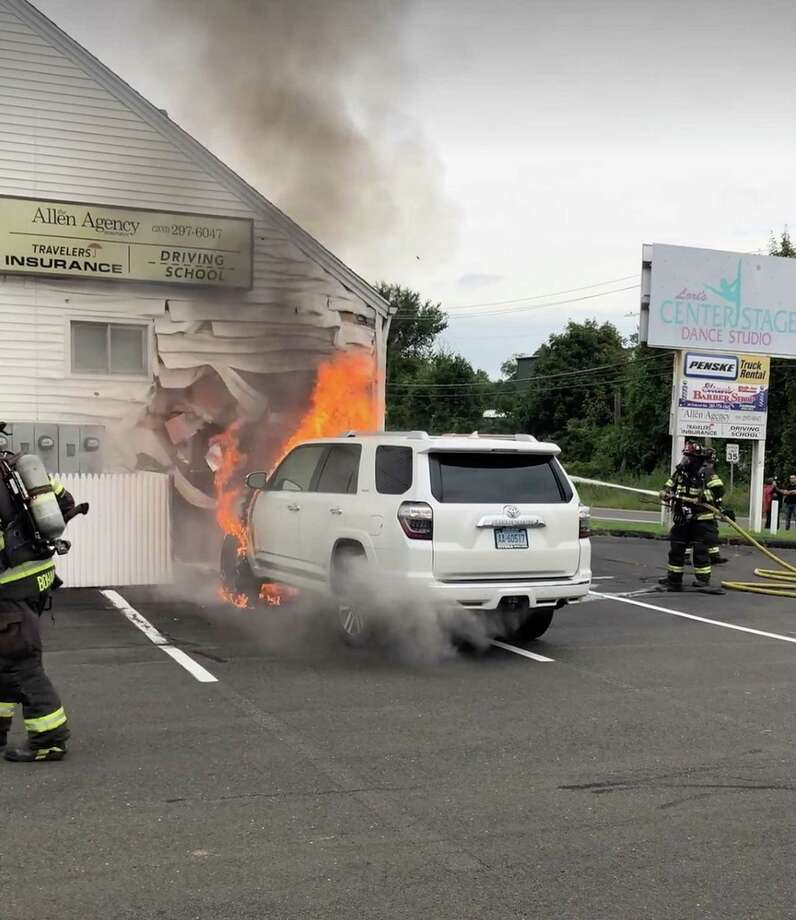 Firefighters extinguish an SUV after it caught fire in close proximity to a building on Federal Road in Danbury, Conn., Sept. 2, 2020. Photo: Danbury Fire Department