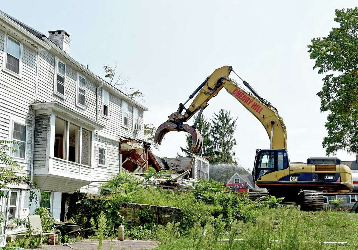 Madison, Connecticut - Tuesday, August 25, 2020: Demolition of the General's Residence at 908 Boston Post Road in Madison began Tuesday. Two items found in the 3,600-square-foot house are puzzling. One is a board, retrieved from the attic, covered with unexplained tally marks, groupings of four lines, completed with a diagonal line to denote groups of five. The tally marks, however, generated interest after Dickinson posted a photo on his Facebook page. Because of the house's alleged dark past, which may be linked to the trade of enslaved people, some people speculated whether the marks could signify the number of days the enslaved people living in the house were hidden, according to local legend. But both architectural historian Rachel Carley and Dickinson dismissed this speculation.