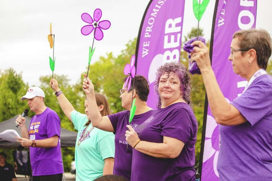 Julie Harvey stands among other people who also lost a relative or friend to Alzheimer's. Julie's father, Paul, passed away at age 85. Photo: For The Intelligencer