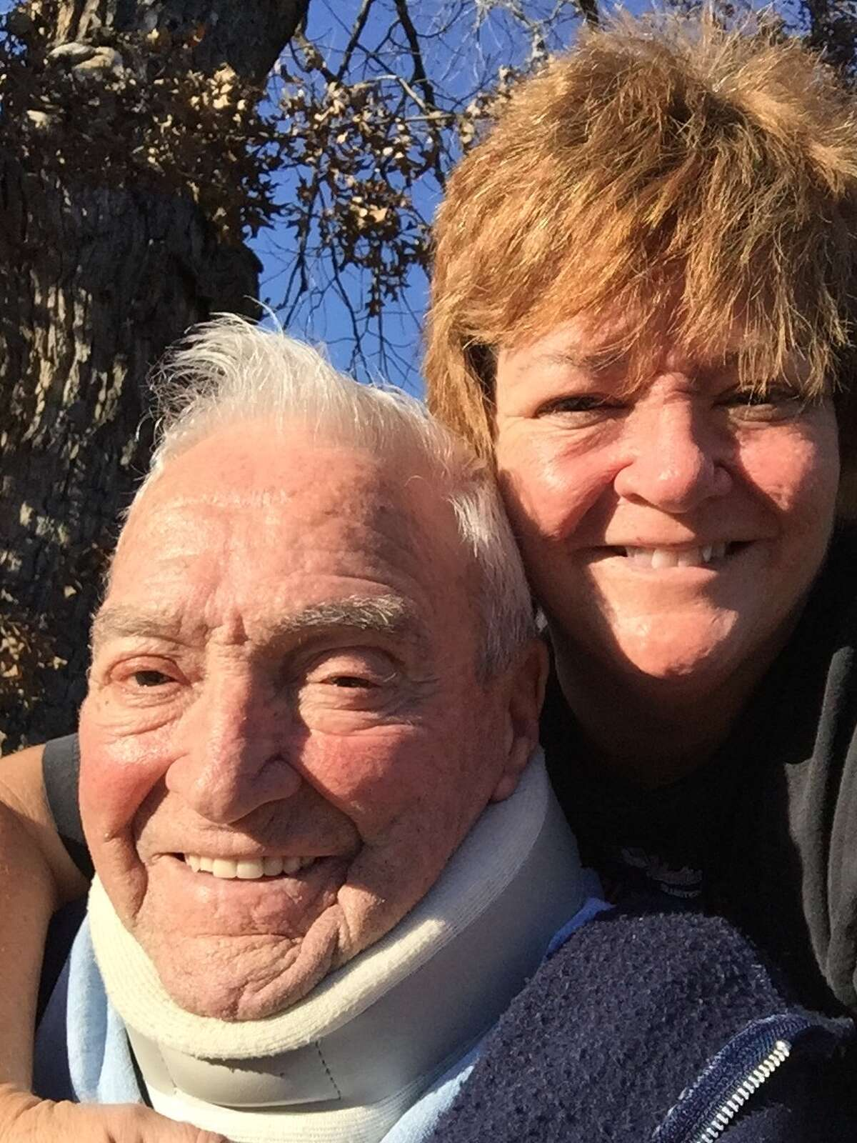 Julie Harvey with her father, Paul, a few years ago. She often took him for walks in Glazebrook Park in Godfrey. Paul died from Alzheimer's Disease in 2016.