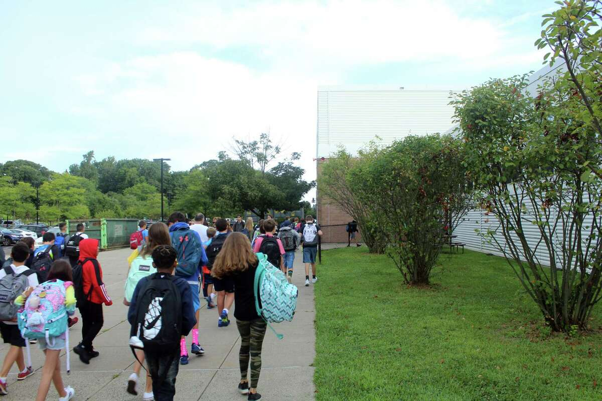 Students arrived early for their first day back at Bedford Middle School in Westport on Aug. 27, 2019.