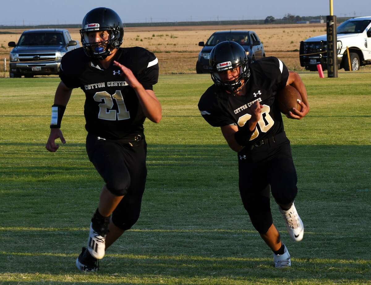 Cotton Center's Zeke Saenz looks to block for ball carrier Bronson Alvarado during the Elks' 49-44 win over Southland in Cotton Center on Thursday, Aug. 27.