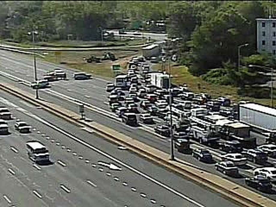 A motorcycle driver and a passenger were seriously injured after a vehicle struck the rear of a Honda motorcycle on westbound I-84 in East Hartford on Thursday, Sept. 3, 2020. The crash that happened before 3 p.m. near exit 57, closed all westbound lanes for hours. The highway closure, just as the afternoon rush hour was beginning, caused near gridlock conditions in East Hartford and Hartford. Traffic was detoured off I-84. Photo: CT DOT Traffic Cam Image