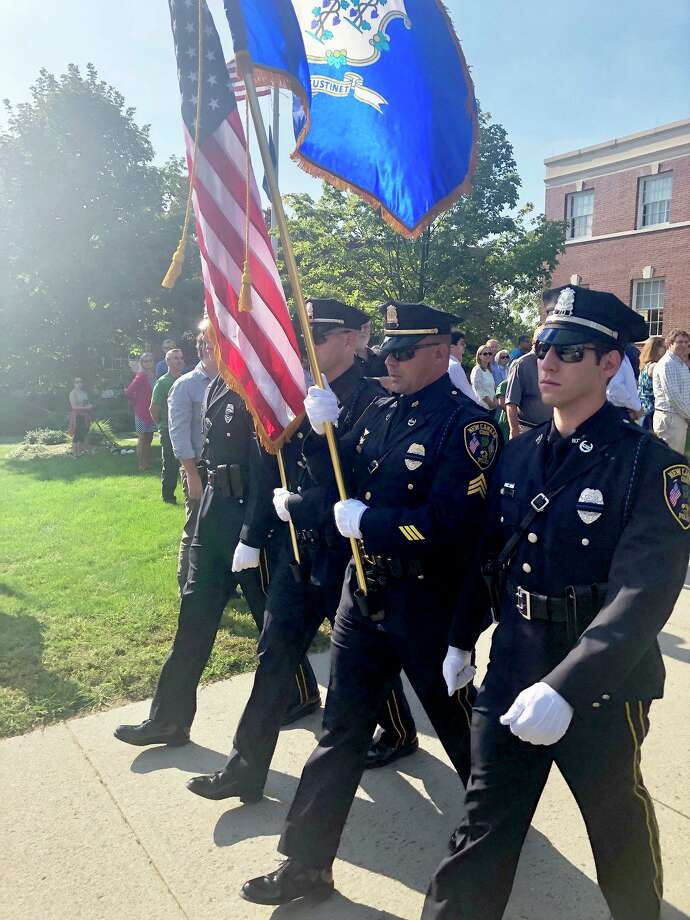 New Canaan Police marched in front of New Canaan Town Hall for the annual 9/11 Memorial Ceremony on Sept. 11, 2019. Photo: Contributed Photo / Hearst Connecticut Media