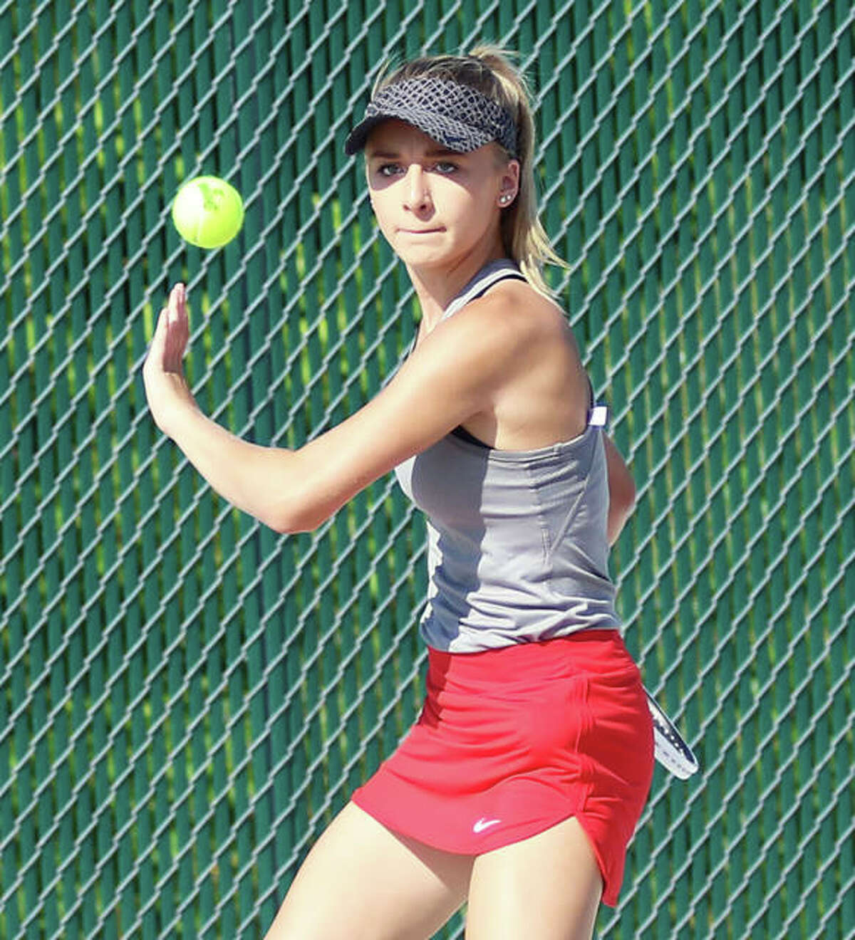 Alton's Ainsley Fortschneider, shown returning a shot in an Aug. 22 dual with Roxana at the Alton High courts in Godfrey, was in Jerseyville with the Redbirds on Thursday. Fortschneider picked up one of Alton's two singles victories, but the Panthers won the dual 7-2.