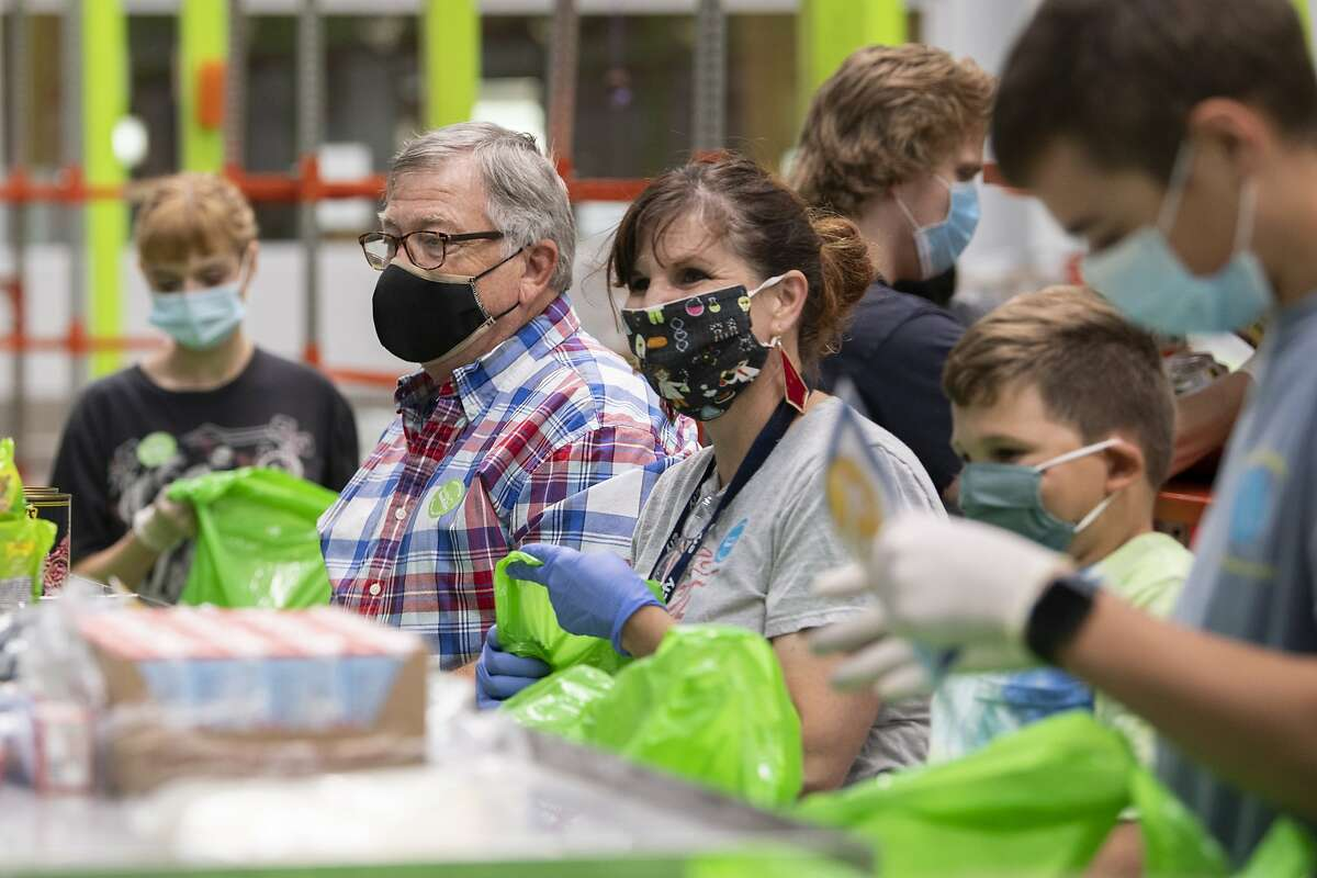 Volunteers were crucial to responding to food needs during the coronavirus pandemic at the Houston Food Bank.