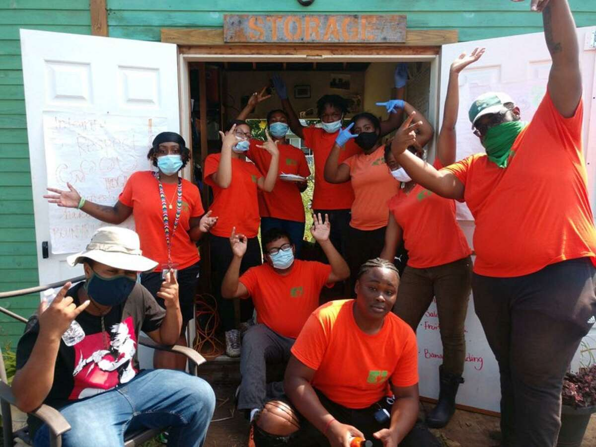 Members of the 2020 Green Village Initiatives Youth Farm Crew at the Reservoir Community Farm on Reservoir Avenue in Bridgeport, Conn.
