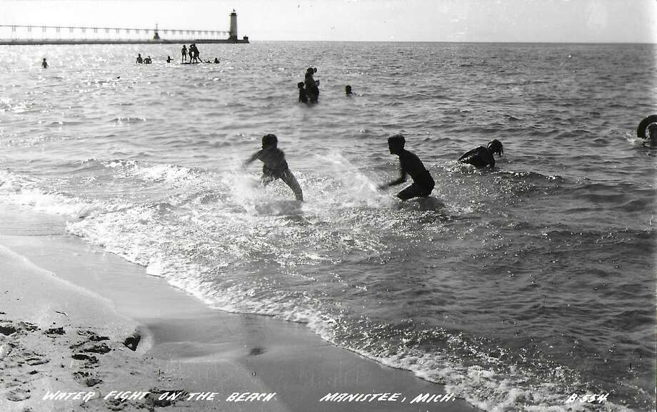 Swimmers could be seen splashing around at Fifth Avenue Beach circa late 1940s. (Manistee County Historical Museum photo)