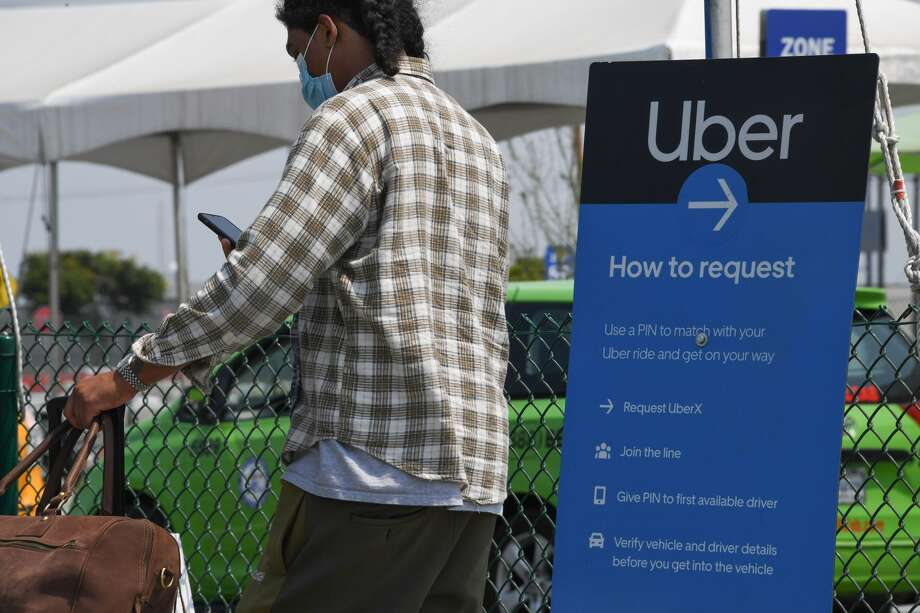 Uber's new mask verification feature will roll out to the US and Canada by the end of September, and across Latin America and other countries after that, according to their website. Photo: ROBYN BECK/AFP Via Getty Images