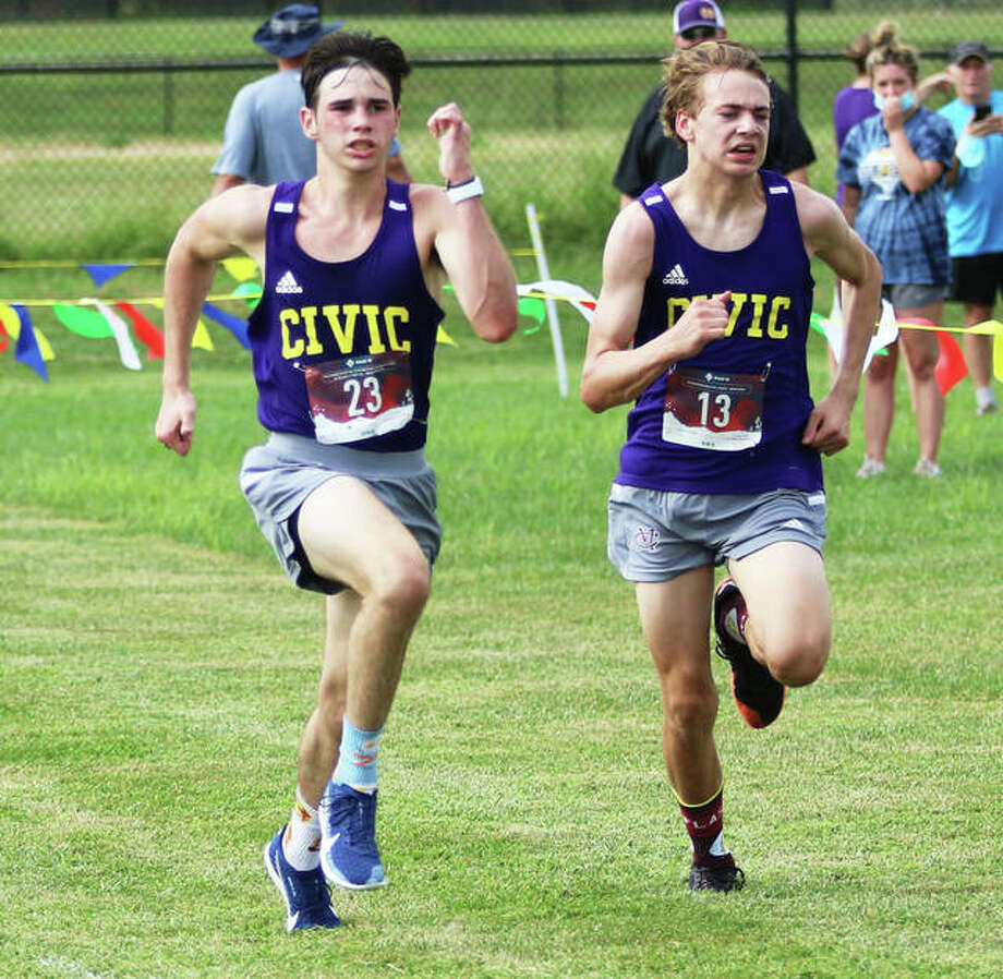 CM's Evan Zobrist (left) and Jackson Collman sprint to the finish line in an Aug. 26 race at the Bethalto Sports Complex. Zobrist placed fourth in the dual meet with Roxana in 18:35, with Collman fifth in 18:36. Photo: Greg Shashack / The Telegraph