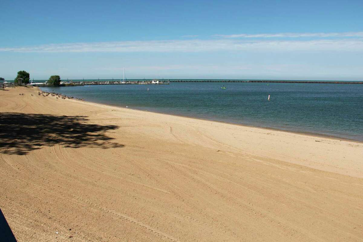 The beach at Bird Creek Park in Port Austin. The beach has been closed twice this year due to high E. coli levels. (Robert Creenan/Huron Daily Tribune)
