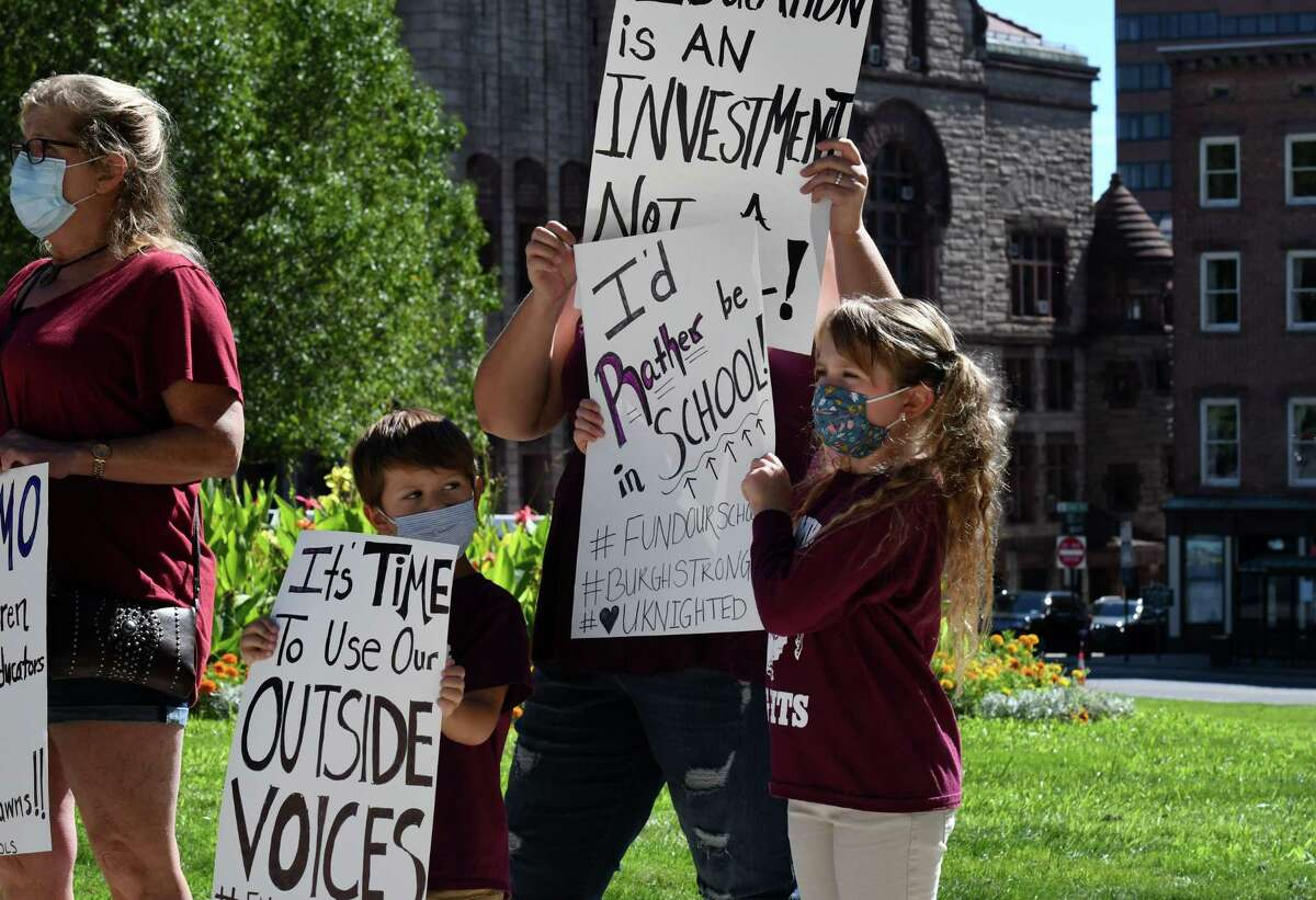 Lansingburgh students Noah, left, and Madison Trotter, right, attend a recent rally at the Capitol calling on Gov. Andrew Cuomo to restore school funding. Noah is a pre-k student and Madison is starting third grade through distance learning. (Will Waldron/Times Union)