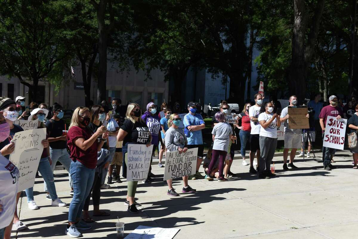 Parents and supporters from the Lansingburgh and Albany school districts hold a rally outside the Capitol to call on Gov. Cuomo to restore school funding recently cut by the state on Friday, Sept. 4, 2020, in Albany, N.Y. (Will Waldron/Times Union)