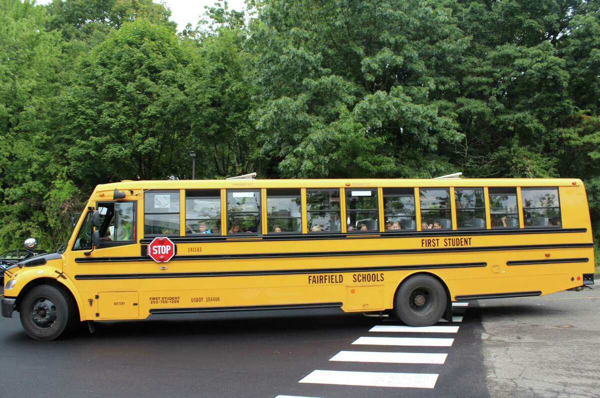 A school bus pulls away after the first day of school on Sept. 1, 2016 at Mill Hill Elementary School in Fairfield, Conn.