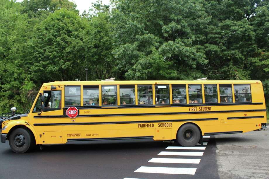 A school bus pulls away after the first day of school on Sept. 1, 2016 at Mill Hill Elementary School in Fairfield, Conn. Photo: Laura Weiss / Hearst Connecticut Media / Fairfield Citizen