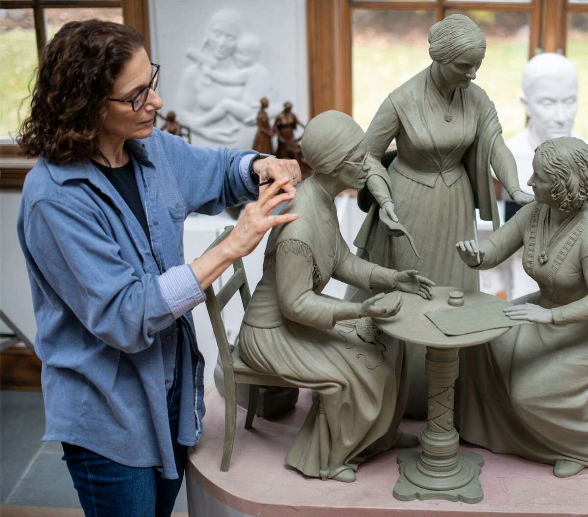 Ridgefield artist Meredith Bergmann works on a model of a sculpture that was unveiled in Central Park in New York City last week. The 14-foot-tall bronze monument depicts Susan B. Anthony, Sojourner Truth and Elizabeth Cady Stanton, three of the more prominent leaders in the nationwide fight for women's right to vote.