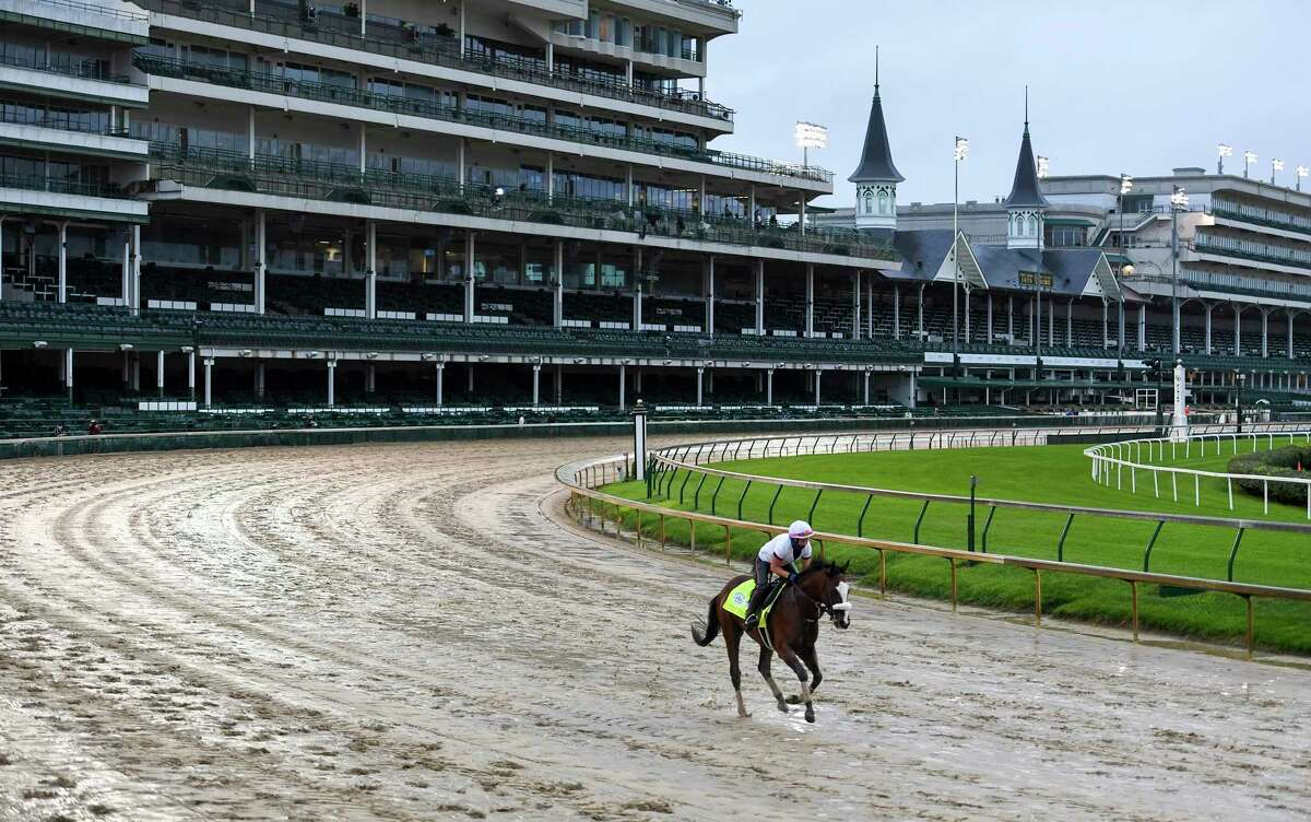 Derby favorite Tiz the Law with exercise rider Heather Smullen get their first look at a very sloppy Churchill Downs main track Wednesday Sept. 2, 2020 In Louisville, KY. Photo by Skip Dickstein/Special to the Times Union