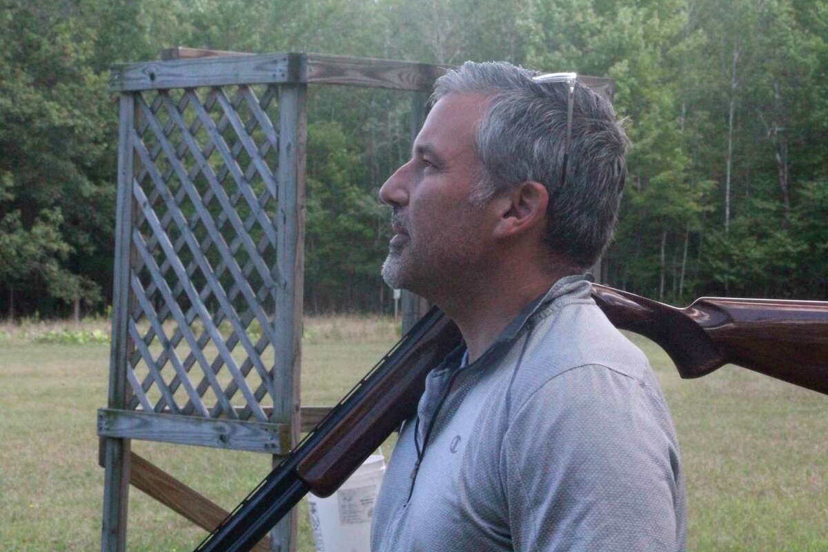 Canadian Lakes' Mark Basso gets ready for the sporting clays shoot at the Mecosta County Rod & Gun club last Saturday. (Pioneer photo/John Raffel)