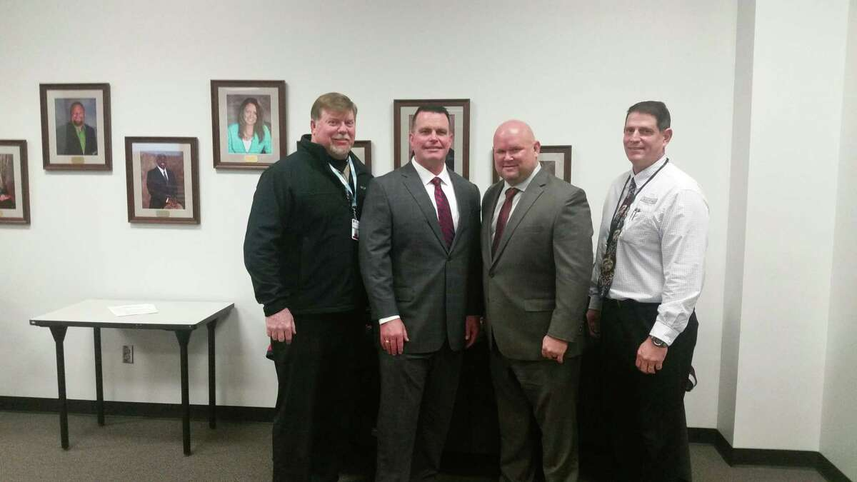 Pearland athletic director Ben Pardo (right) is shown with, from left, assistant athletic director Eric Wells, Dawson head football coach Mike Allison and Pearland head coach Ricky Tullos. Pardo says plans are being finalized for seating at Pearland Stadium.