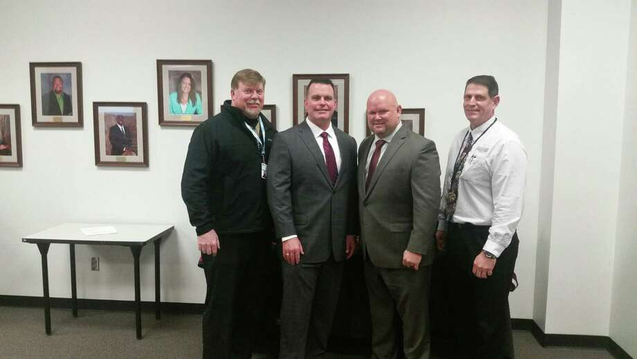 Pearland athletic director Ben Pardo (right) is shown with, from left, assistant athletic director Eric Wells, Dawson head football coach Mike Allison and Pearland head coach Ricky Tullos. Pardo says plans are being finalized for seating at Pearland Stadium. Photo: Ted Dunnam / Ted Dunnam