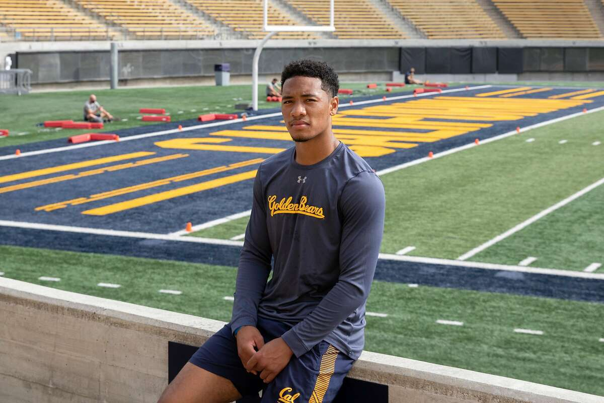 UC Berkeley senior and football cornerback Cam Bynum wears a mask while posing for a portrait on the field inside Cal Stadium at UC Berkeley in Berkeley, Calif. Friday, August 14, 2020. This will bey Bynum's first fall season without football since the 4th grade and feels it will affect his plans to pursue an NFL career.