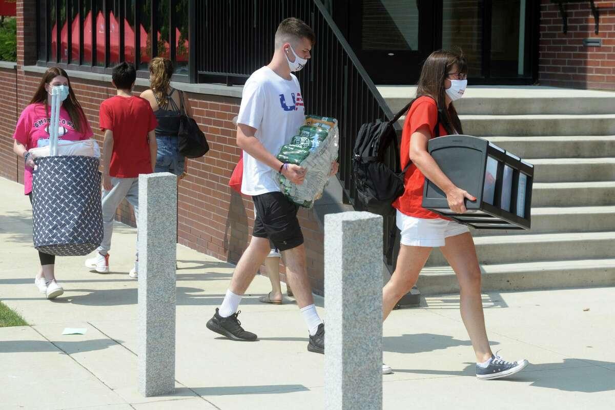 Freshmen arrive on the campus of Sacred Heart University, in Fairfield, Conn. Aug. 25, 2020.