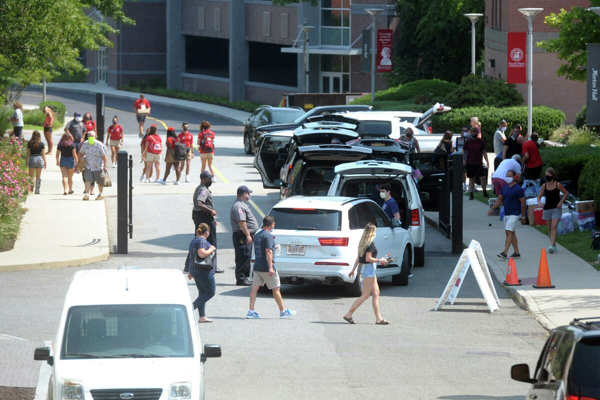 Freshmen arrive on the campus of Sacred Heart University, in Fairfield, Conn. Aug. 25, 2020.