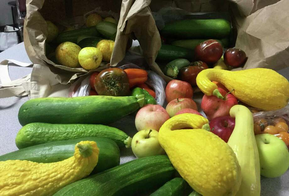Local farmers have donated excess produce to help support the Manistee Senior Center's monthly food banks. Manistee seniors appreciate receiving fresh produce. (Courtesy photo)