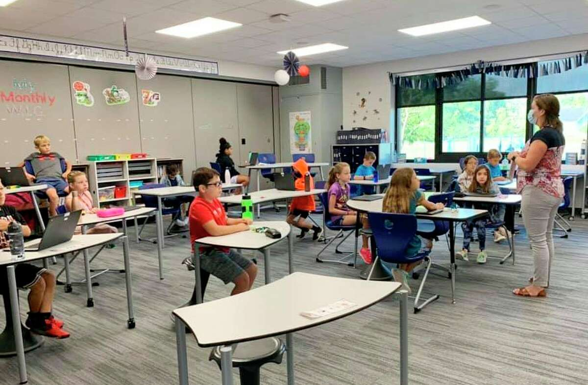 Students at Brookside Elementary School learn in their socially-distanced classroom spaces. With students originally heading back to class in groups, the school will make a full transition with all in-person students in attendance Tuesday. (Courtesy photos)