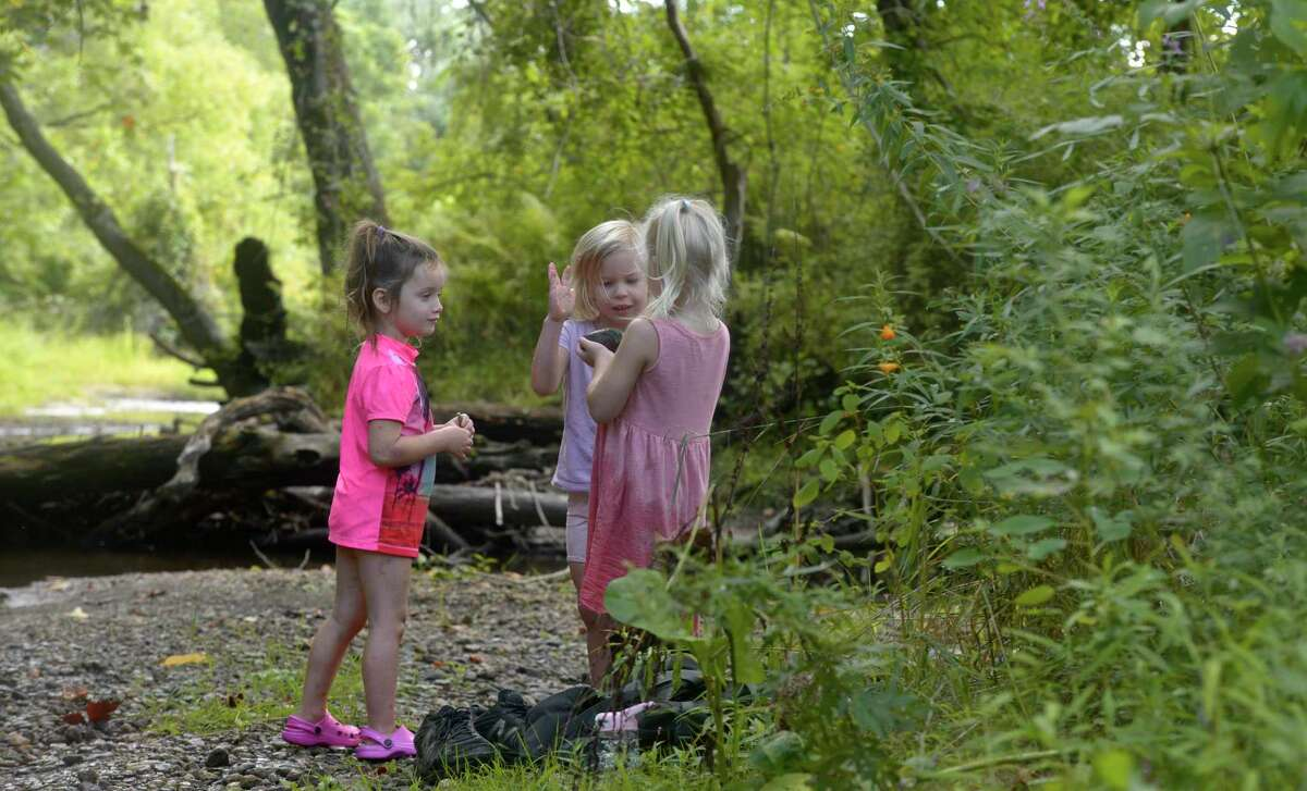 Students explore the East Aspetuck River at the Peter Pratt Nature School at the Pratt Nature Center in New Milford, Conn. The school, which was started last year, has expanded. Friday morning, September 4, 2020.