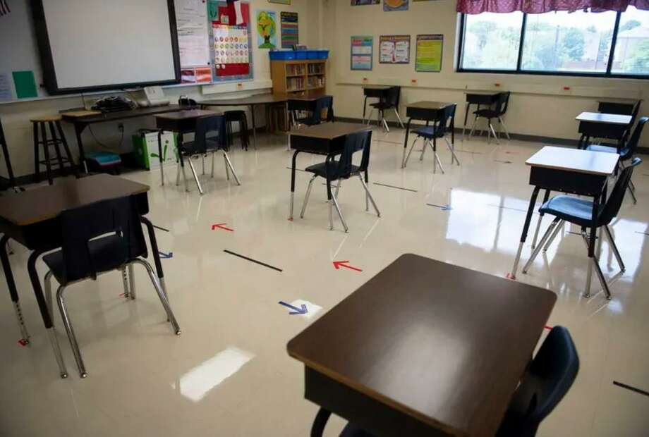 Desks are spaced out in a classroom at an elementary school in San Antonio. Experts say mitigation measures will be critical to preventing coronavirus outbreaks. Photo: Allie Goulding /The Texas Tribune