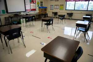 Desks are spaced out in a classroom at Ott Elementary School in San Antonio. Experts say mitigation measures will be critical to preventing coronavirus outbreaks.
