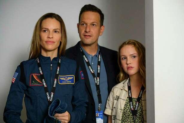 From left: Hilary Swank, Josh Charlies and Talitha Bateman in Netflix's, 'Away'. (Diyah Pera/Netflix/TNS)