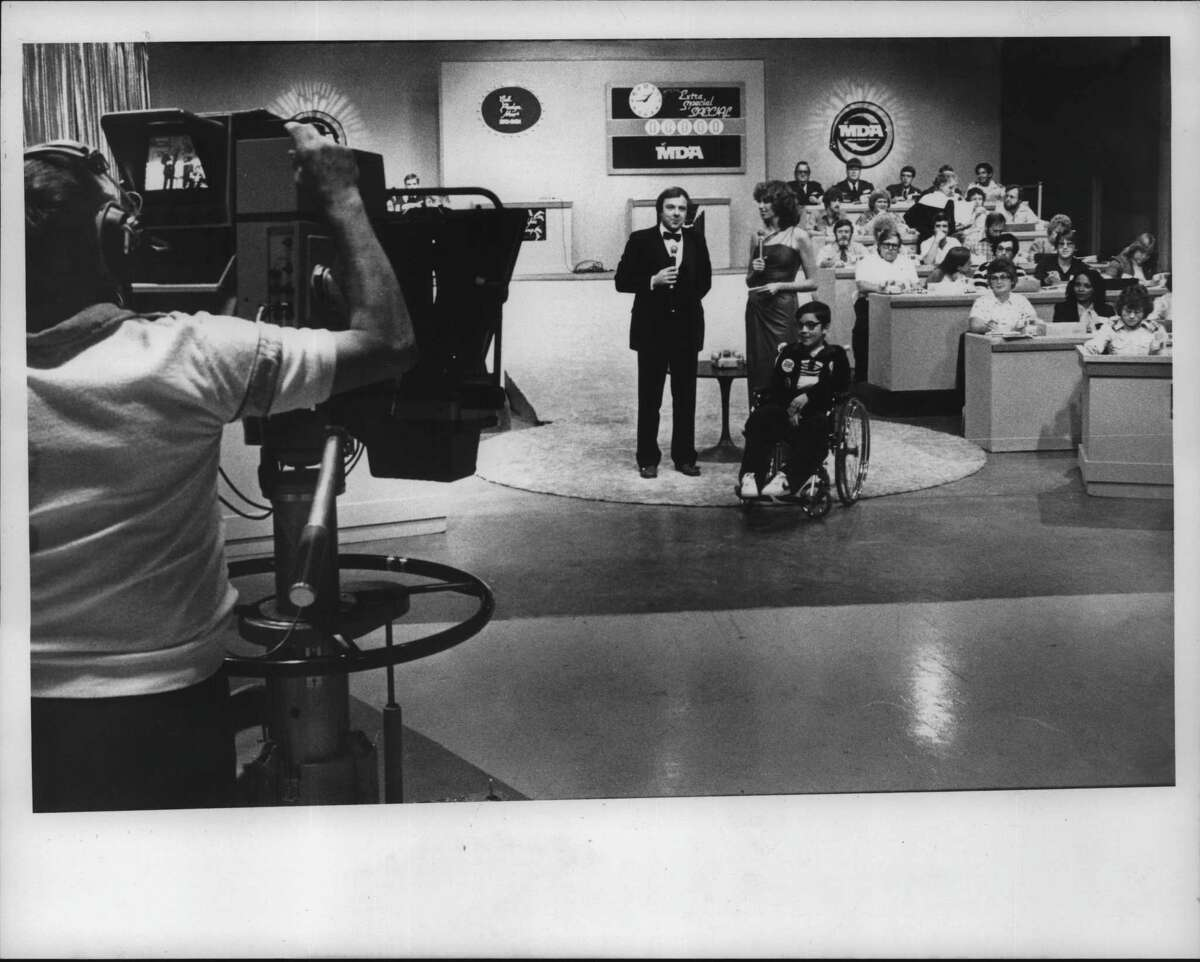 WRGB cameraman gives sign to start the local Muscular Dystrophy Telethon. Seen are Ed Dague, Joselyn Warfield, and Paul Dromms. September 5, 1982 (Tom LaPoint/Times Union Archive)