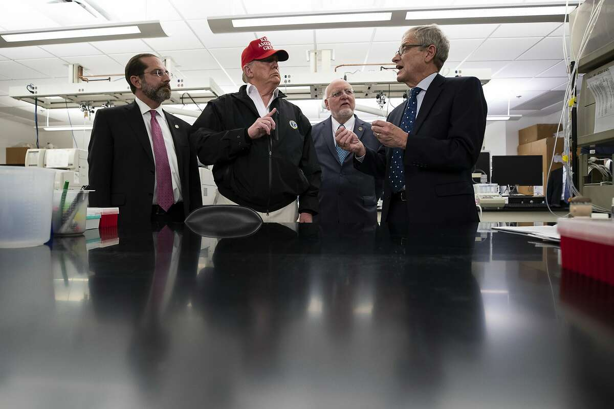 President Donald Trump speaks during a meeting with Health and Human Services Secretary Alex Azar, left, Centers for Disease Control and Prevention Director Robert Redfield, and Associate Director for Laboratory Science and Safety Steve Monroe, about the coronavirus at the Centers for Disease Control and Prevention, Friday, March 6, 2020 in Atlanta. (AP Photo/Alex Brandon)