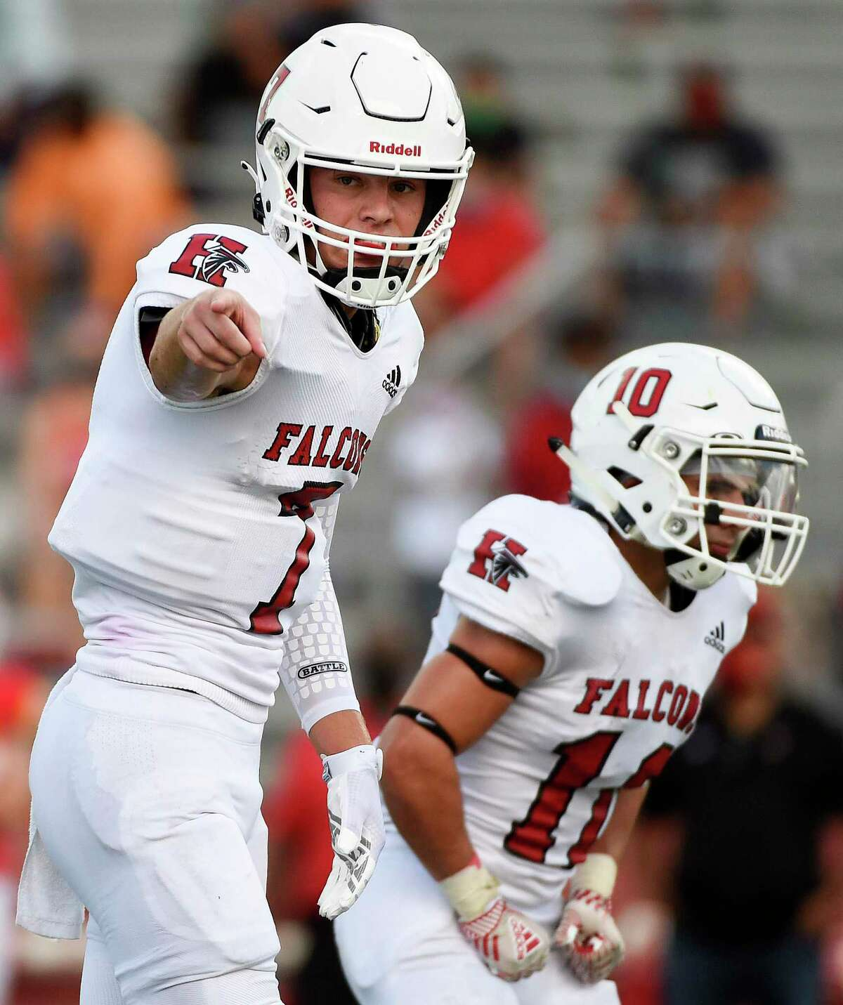 Stafford quarterback Luke Thomas, left, gives instructions during the first half of a high school football game against Stafford, Saturday, Aug. 29, 2020, in Stafford, TX.