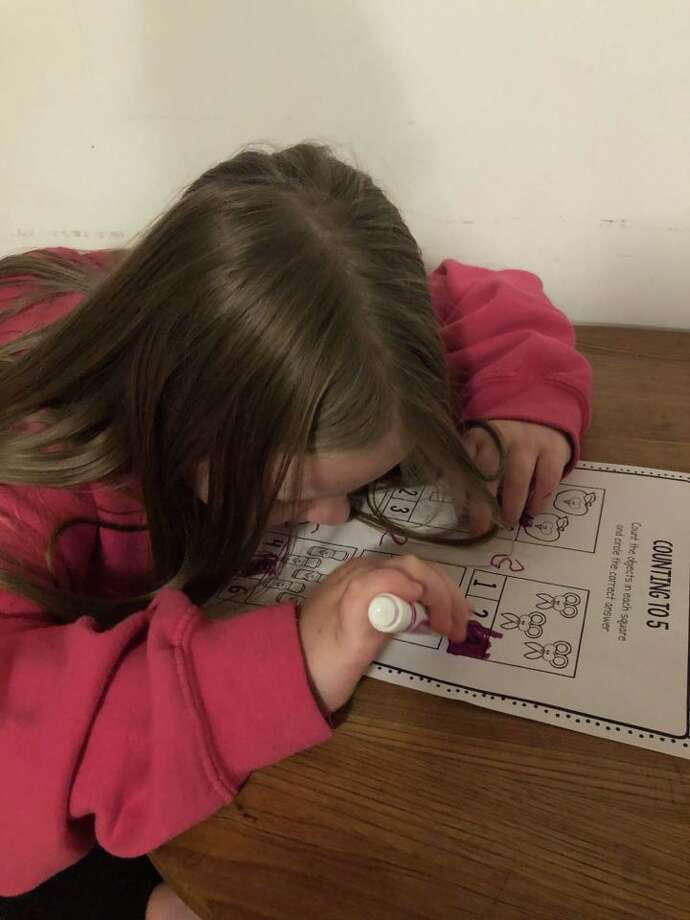 Priscilla Devine, age 5, works on a counting assignment as part of her homeschooling education. Priscilla's mother, Jennifer, formed a network of parents homeschooling kindergartners in order to share resources and ideas. Photo: Courtesy Photo