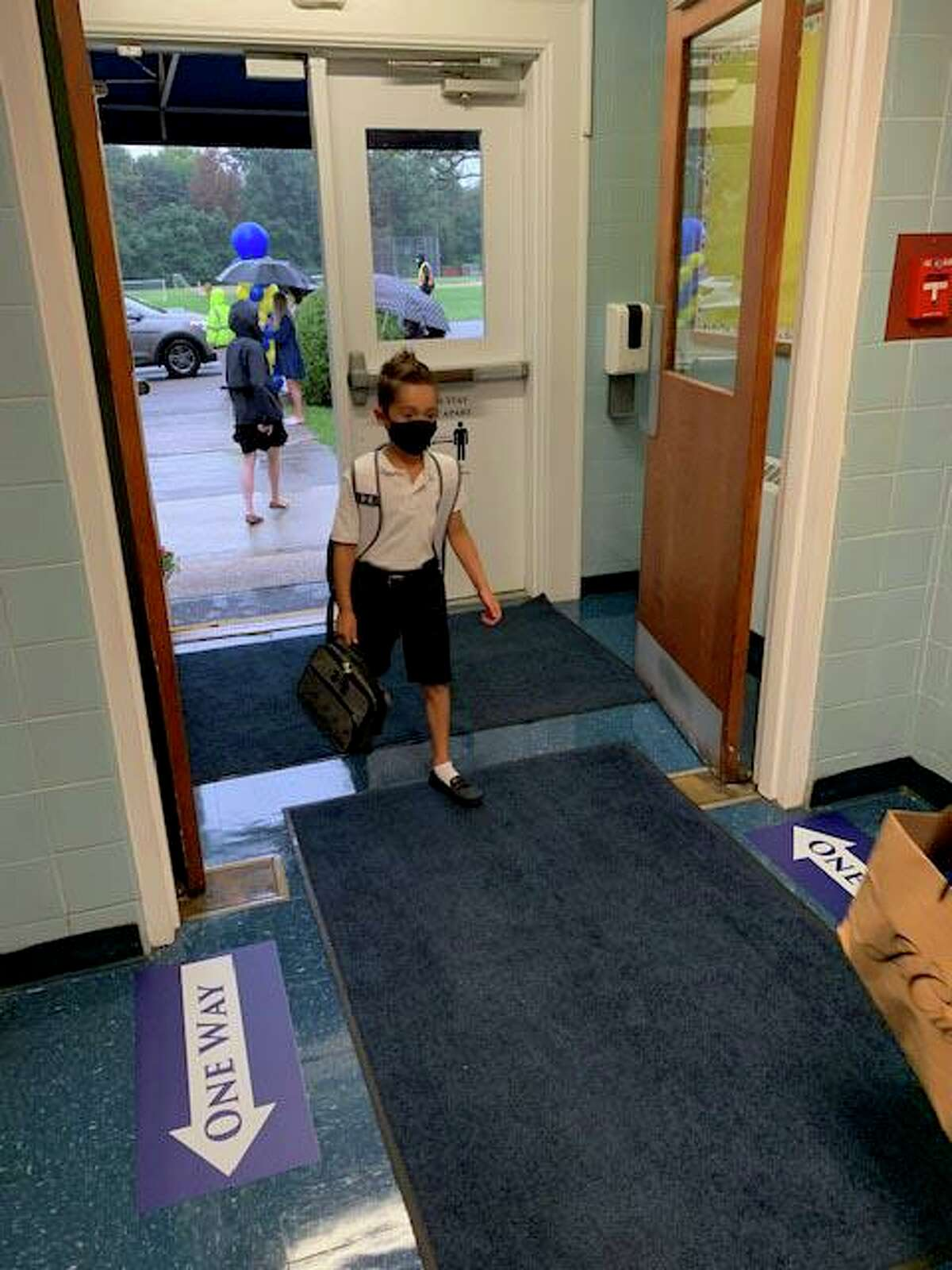 Students head back to class on Wednesday at Greenwich Catholic School.