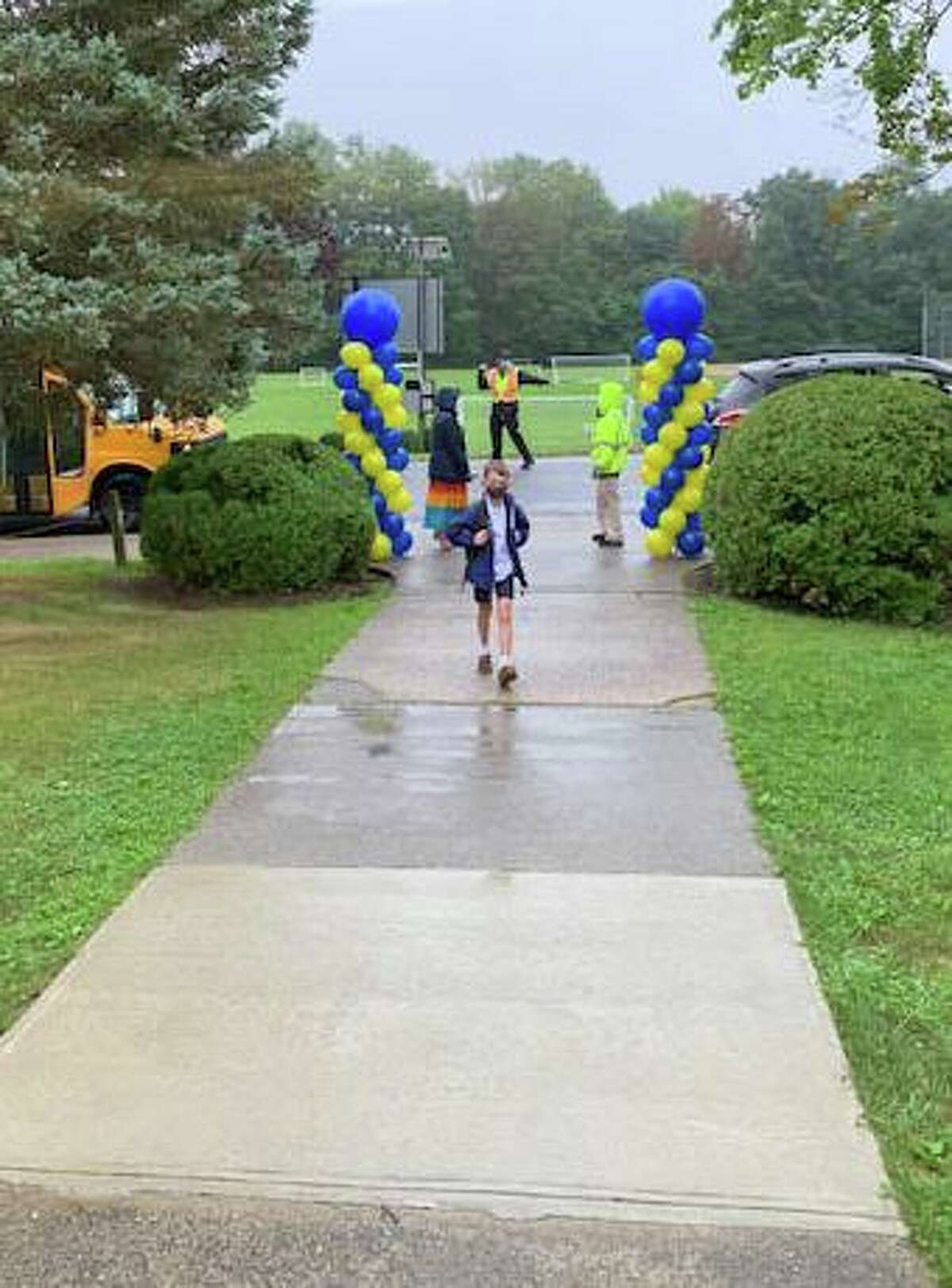 A lower school student arrives for the first day of classes at Greenwich Catholic School last week.